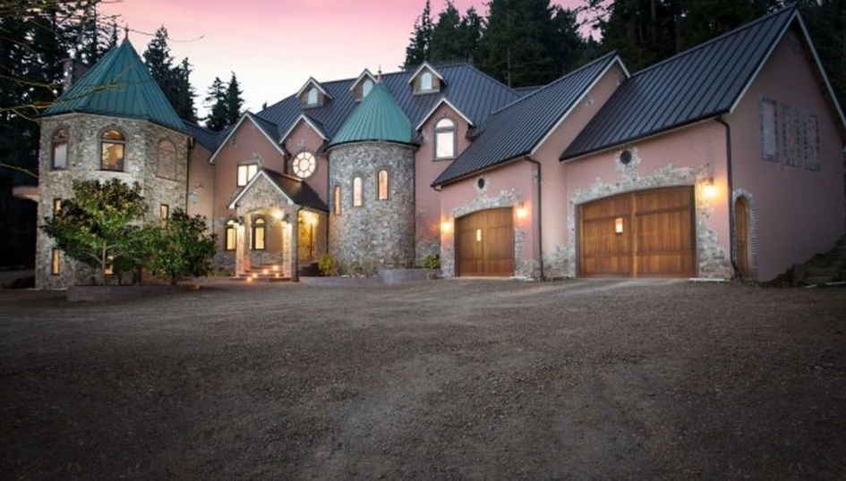 Blackberry Castle hit the market March 2015, selling initially for $7.2M. Over a year later, the Portland property then dropped to $4.9m and then again to $4,750,000, and finally to $4,000,000 - selling by Daniel Lowe of Luxe Christie's International Real Estate. The Castle is magnificent, gated with a private vineyard, hillside wine cellar, five bedrooms, two-story turret library, clock ceiling, atrium bar, home theater, and a rock climbing gym. (Image: Greg Pierce of Capella Photography / Luxe Christie's International Real Estate)