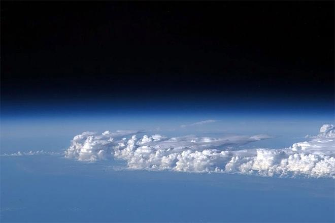 Storm clouds standing tall in the atmosphere over Africa. (Photo & Caption: Chris Hadfield/NASA)