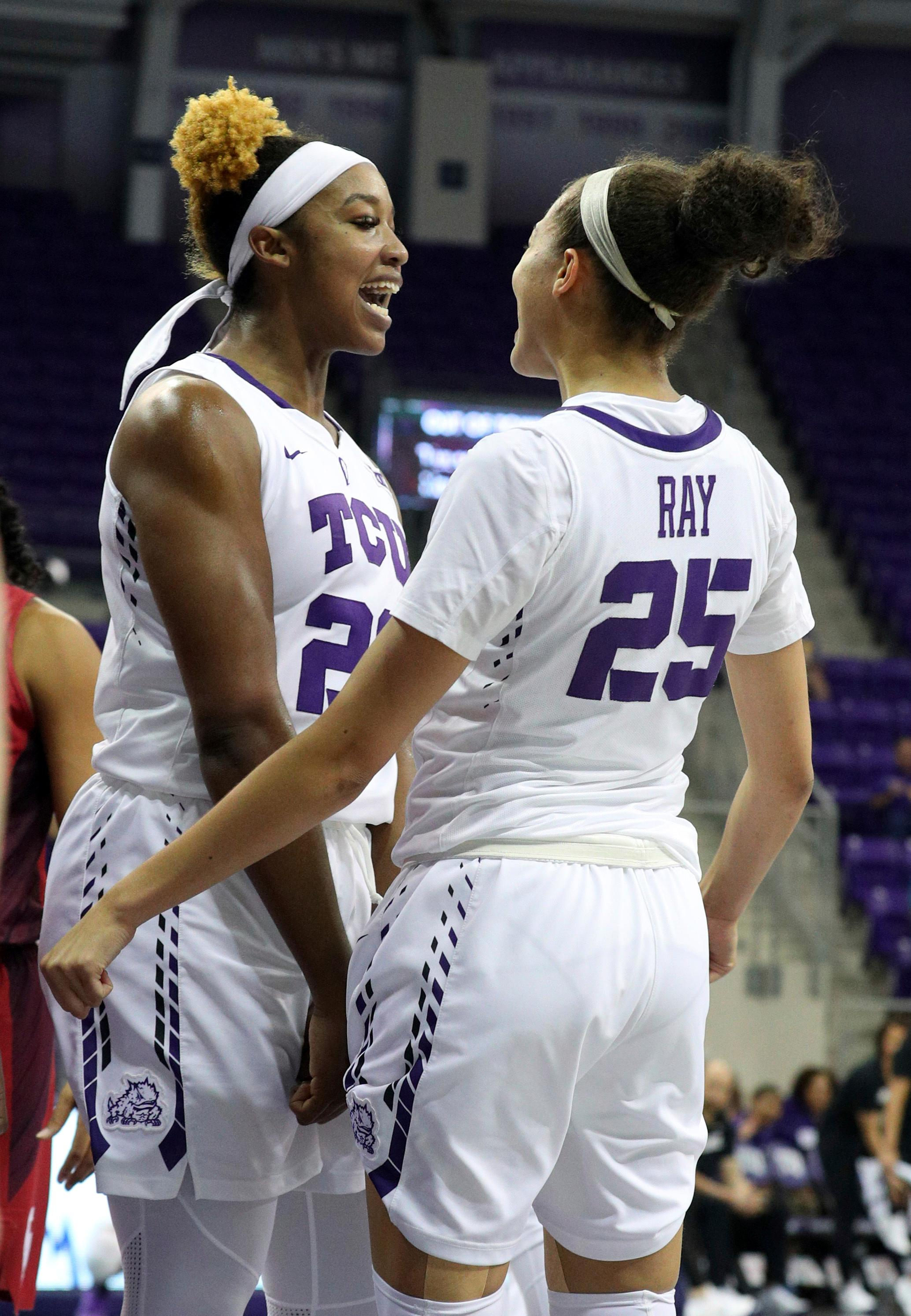 TCU center Jordan Moore (22) and guard Kianna Ray (25) celebrate after a basket against Oklahoma during an NCAA college basketball game in Fort Worth, Texas, Saturday, Jan. 27, 2018. (Richard W. Rodriguez/Star-Telegram via AP)