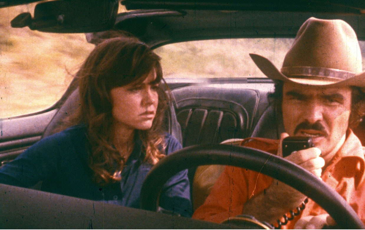 Burt Reynolds (as 'Bandit'/Bo Darville), Sally Field (as Carrie/'Frog' Jerry Reed) Smokey and the Bandit (1977) Directed by Hal Needham USA - 1977  Where: United States When: 04 Feb 1977 Credit: WENN.com  **WENN does not claim any ownership including but not limited to Copyright or License in the attached material. Fees charged by WENN are for WENN's services only, and do not, nor are they intended to, convey to the user any ownership of Copyright or License in the material. By publishing this material you expressly agree to indemnify and to hold WENN and its directors, shareholders and employees harmless from any loss, claims, damages, demands, expenses (including legal fees), or any causes of action or allegation against WENN arising out of or connected in any way with publication of the material.**