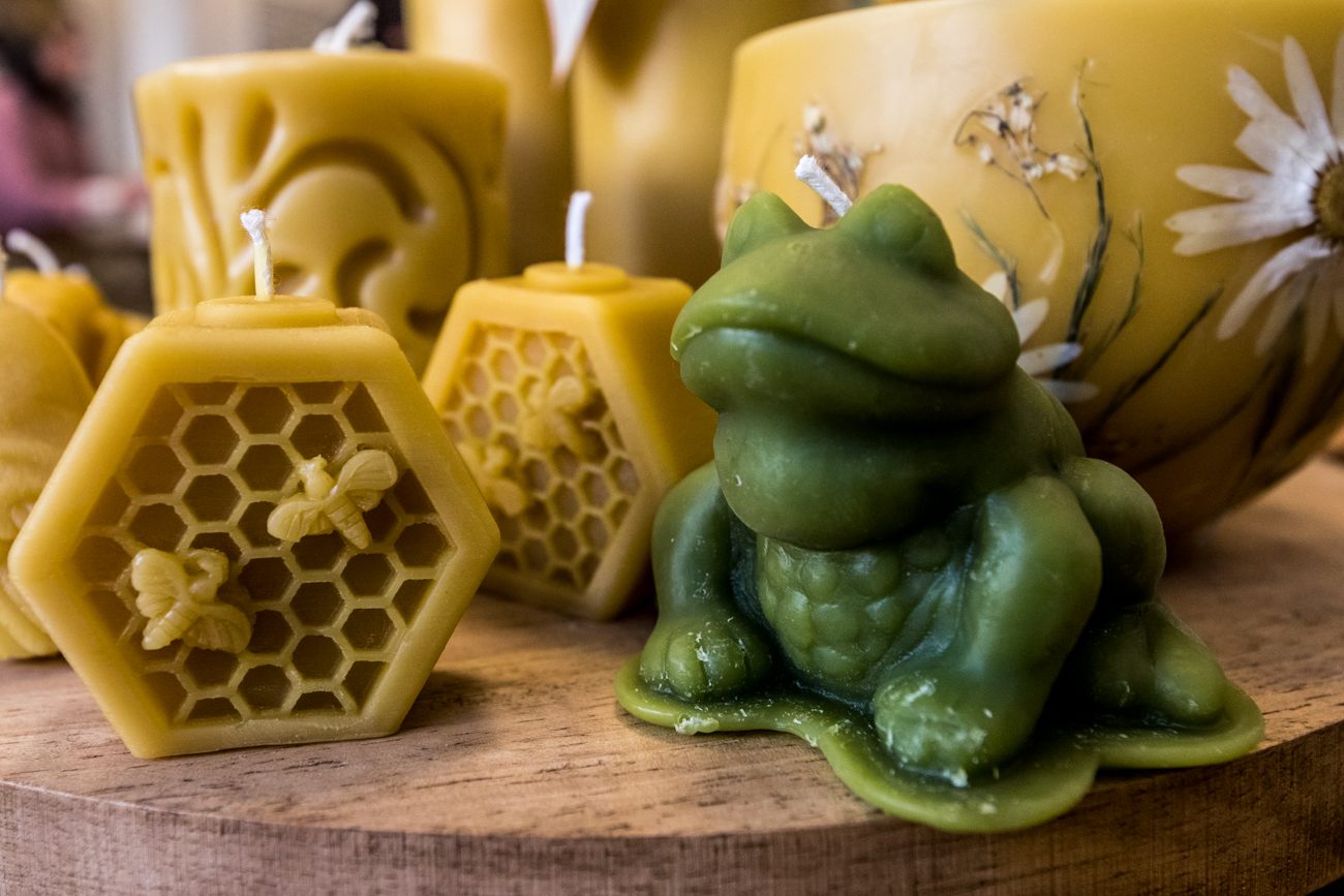 From the honey, wax, pollen, and propolis they collect from the bees, the Gordons make natural products like 100 percent beeswax, hand lotions, lip balms, candles, and beeswax lanterns. The lanterns are hand-dipped and the candles are made by pouring wax into molds. / Image: Catherine Viox // Published: 3.1.20