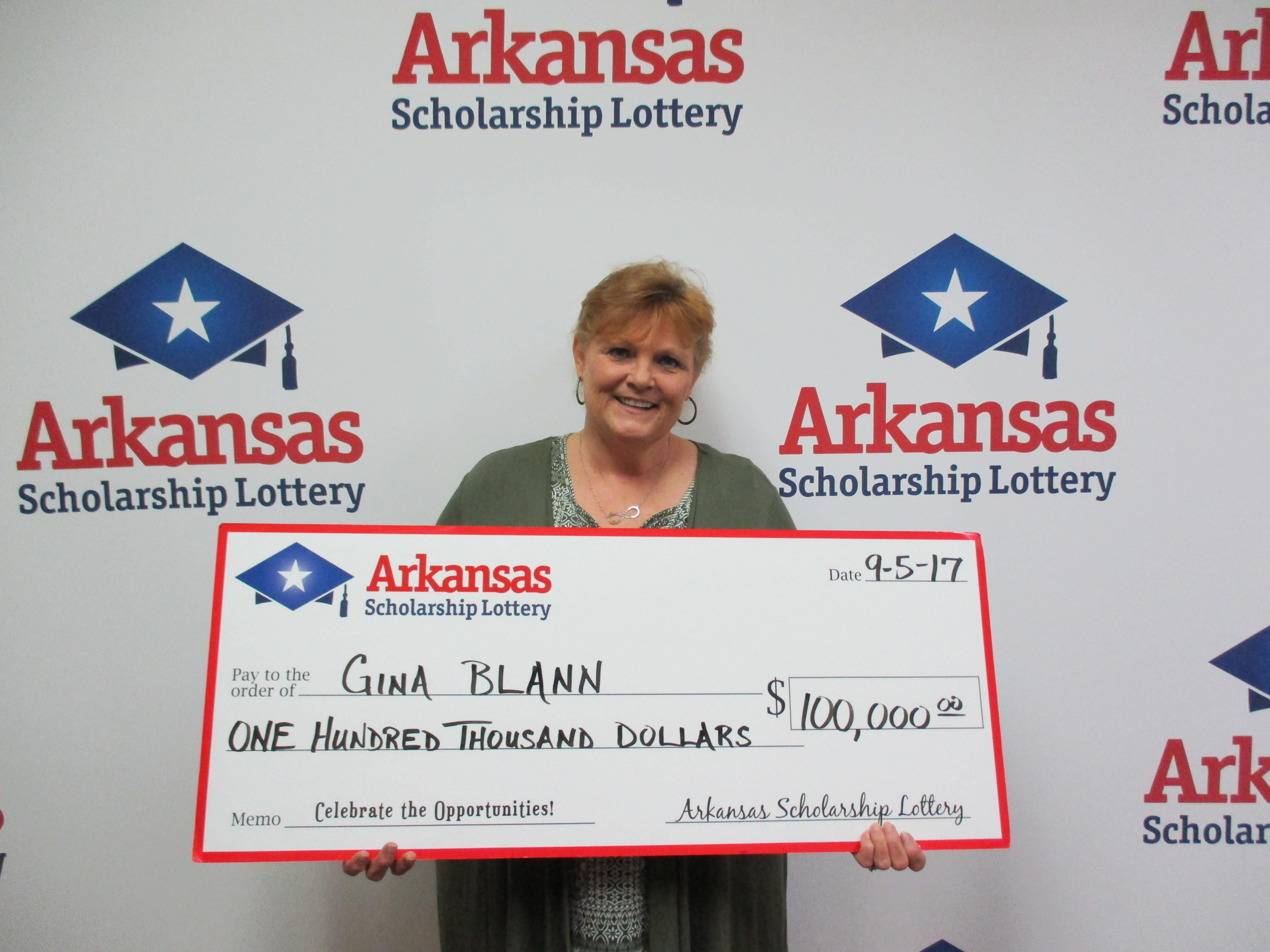 Gina Blann picked up her ticket at the Tobacco Warehouse in Camden and plans to pay off bills. (Photo courtesy: Arkansas Scholarship lottery)