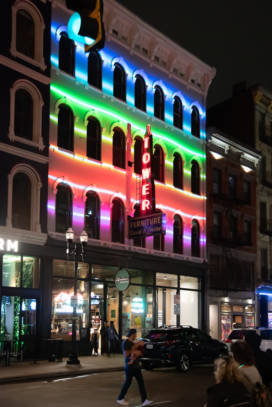 PICTURED NEIGHBORHOOD: Over-the-Rhine / The Tower Furniture building on Main Street is lit up for BLINK. / Image: Phil Armstrong // Published: 10.12.19