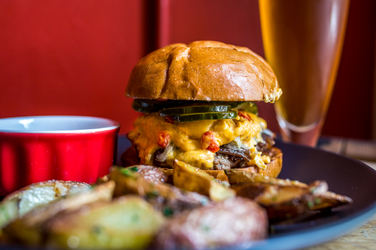PLACE: Bouquet / ADDRESS: 519 Main Street (Covington) / Bouquet's Impossible meatless burger is topped with house-made pimento cheese, house-made pickles, mad sauce, and a little bit of aioli served with potatoes. Get the Impossible burger there before supplies run out. / Image: Catherine Viox // Published: 7.2.19