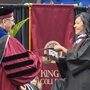 Daughter surprises stepdad with last name change at King's College graduation