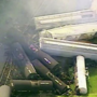 Propane fire extinguished at train derailment, small sulfur fires continue to burn