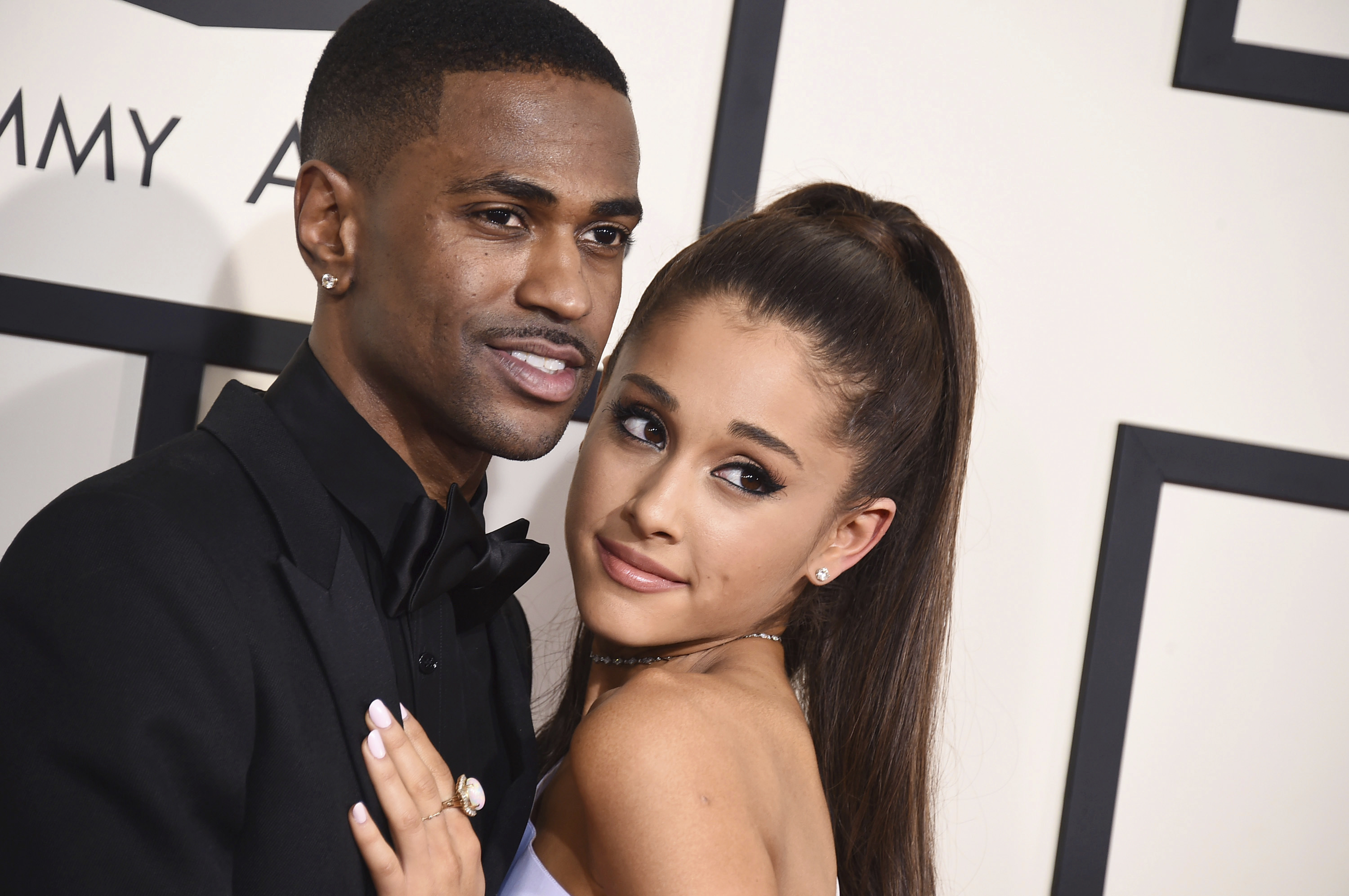 "FILE- In this Feb. 8, 2015, file photo Big Sean, left, and Ariana Grande arrive at the 57th annual Grammy Awards at the Staples Center in Los Angeles. Grande has released a song referencing her exes, including former fiance and ""SNL"" star Pete Davidson and the late Mac Miller. (Photo by Jordan Strauss/Invision/AP, File)"