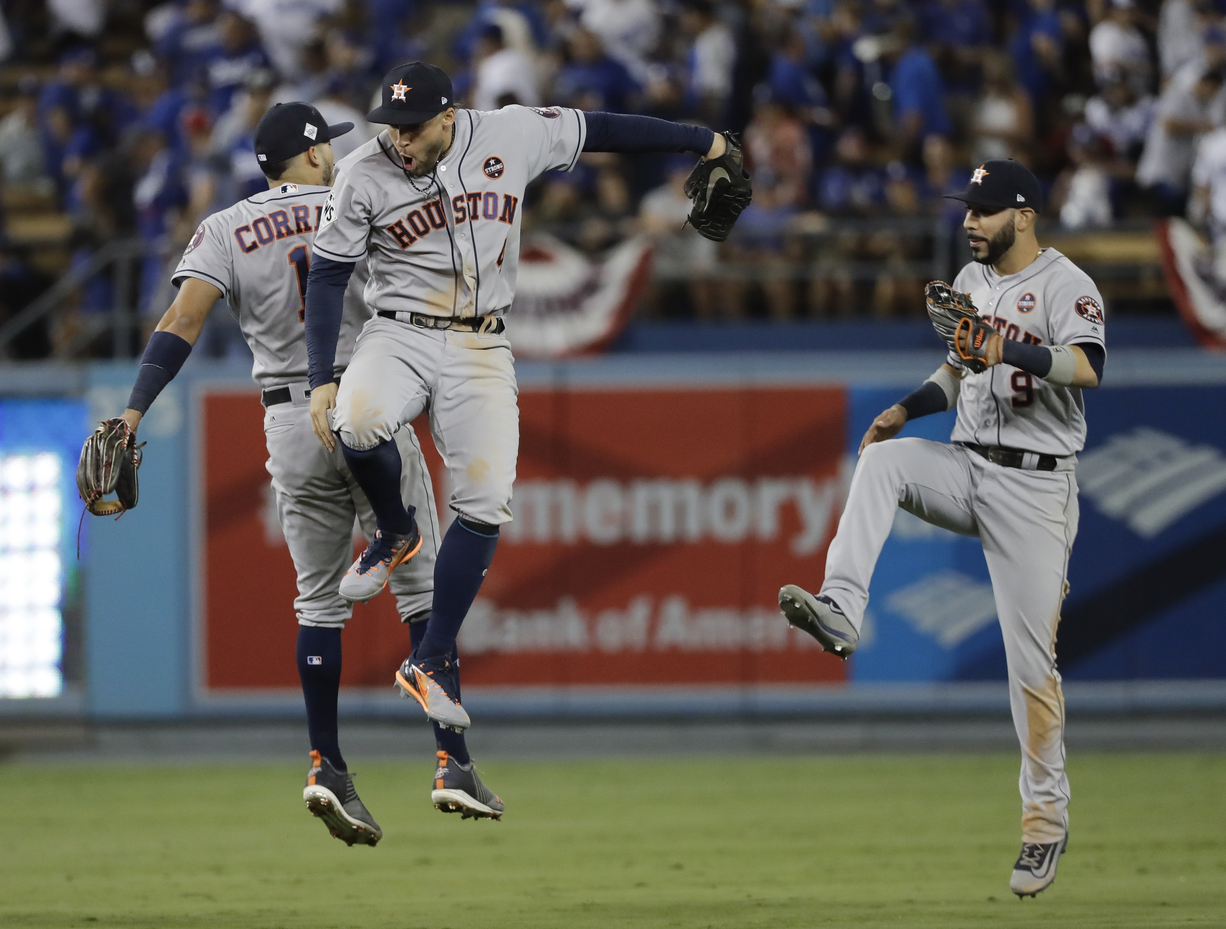 Houston Astros' Carlos Correa, George Springer one Marwin Gonzalez celebrate after Game 2 of baseball's World Series against the Los Angeles Dodgers Wednesday, Oct. 25, 2017, in Los Angeles. The Astros won 7-6 to tie the series at 1-1. (AP Photo/David J. Phillip)
