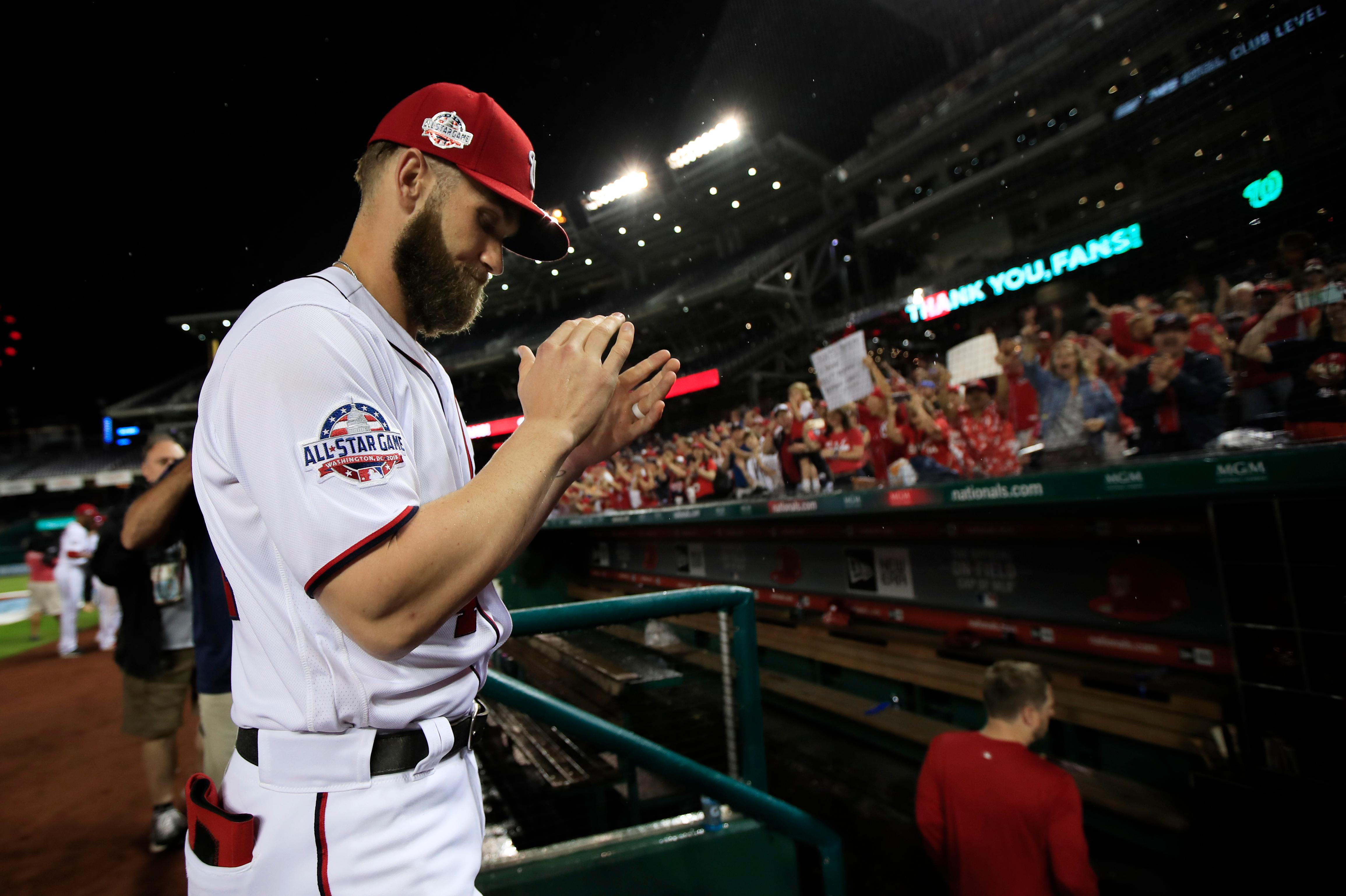 Washington Nationals Bryce Harper claps his hands as he leaves the field after the Nationals ended their last home game of the season with a 9-3, rain-shortened win against the Miami Marlins in Washington, Wednesday, Sept. 26, 2018. (AP Photo/Manuel Balce Ceneta)