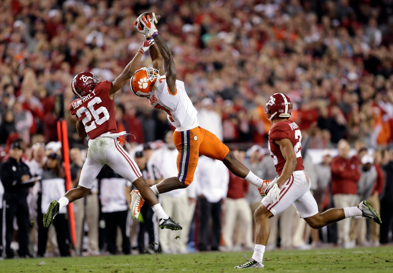 Clemson's Mike Williams catches a pass in front of Alabama's Marlon Humphrey during the second half of the NCAA college football playoff championship game Tuesday, Jan. 10, 2017, in Tampa, Fla. (AP Photo/Chris O'Meara)