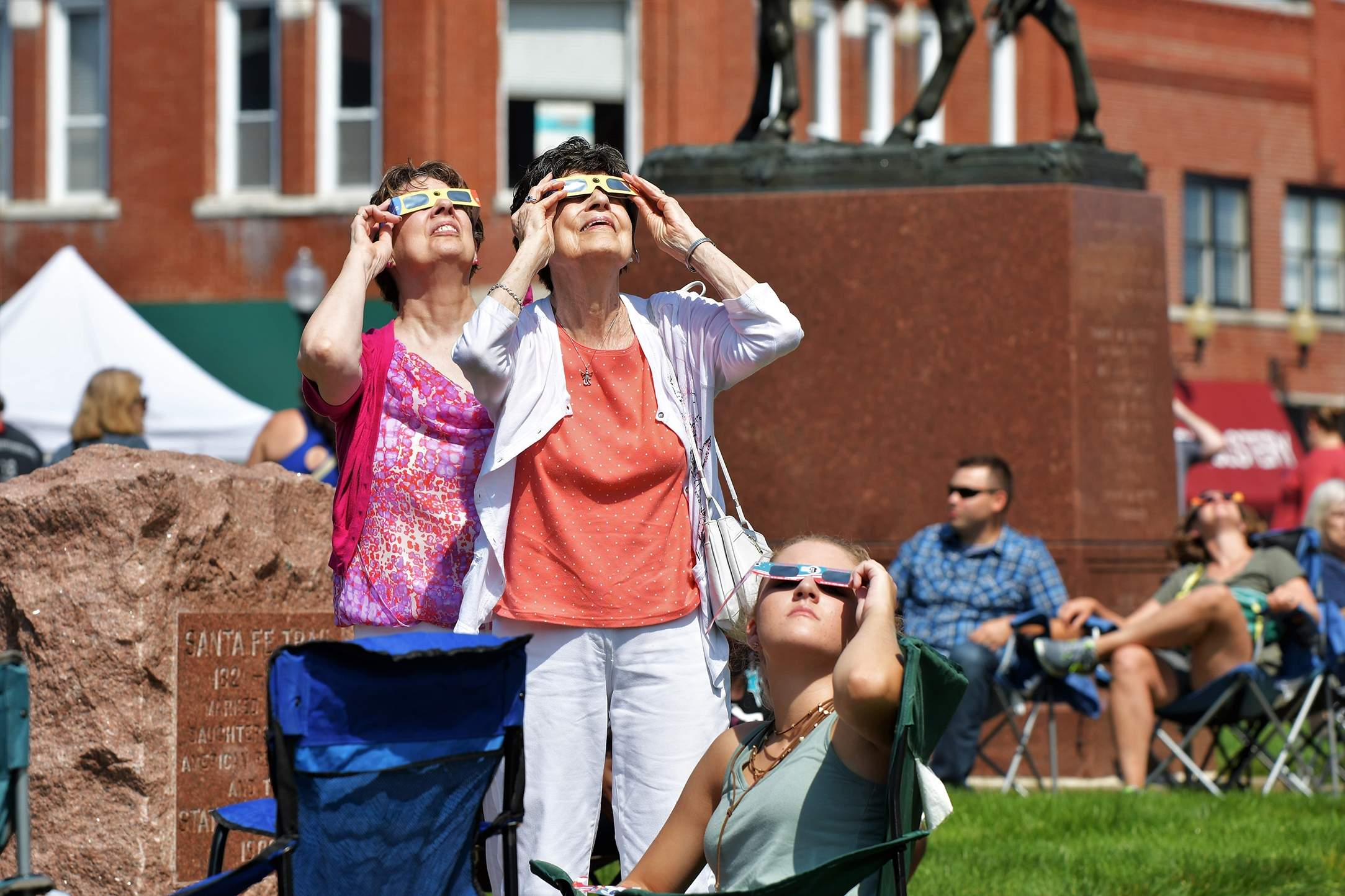 Spectators at the Independence Square view the start of the partial eclipse. [David M. Rainey/Special to The Examiner]