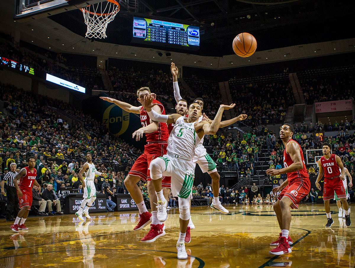 Oregon Ducks Elijah Brown (#5) loses control of the ball on his way to the basket. The Utah Utes defeated the Oregon Ducks 66-56 on Friday night at Matthew Knight Arena. This is the first Pac-12 conference game loss at home for the Ducks since January of 2015. This also ended the five home game winning streak for the Ducks against the Utah Utes. Photo by Rhianna Gelhart, Oregon News Lab