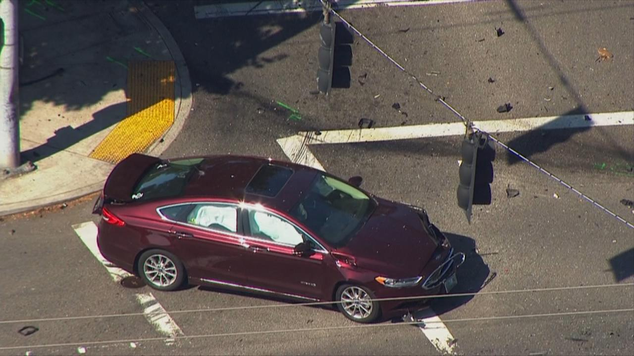 A damaged car can be seen at Southeast 148th Avenue and Powell Boulevard after a hit-and-run crash killed one and injured several others. (Photo: Chopper 2/KATU News)