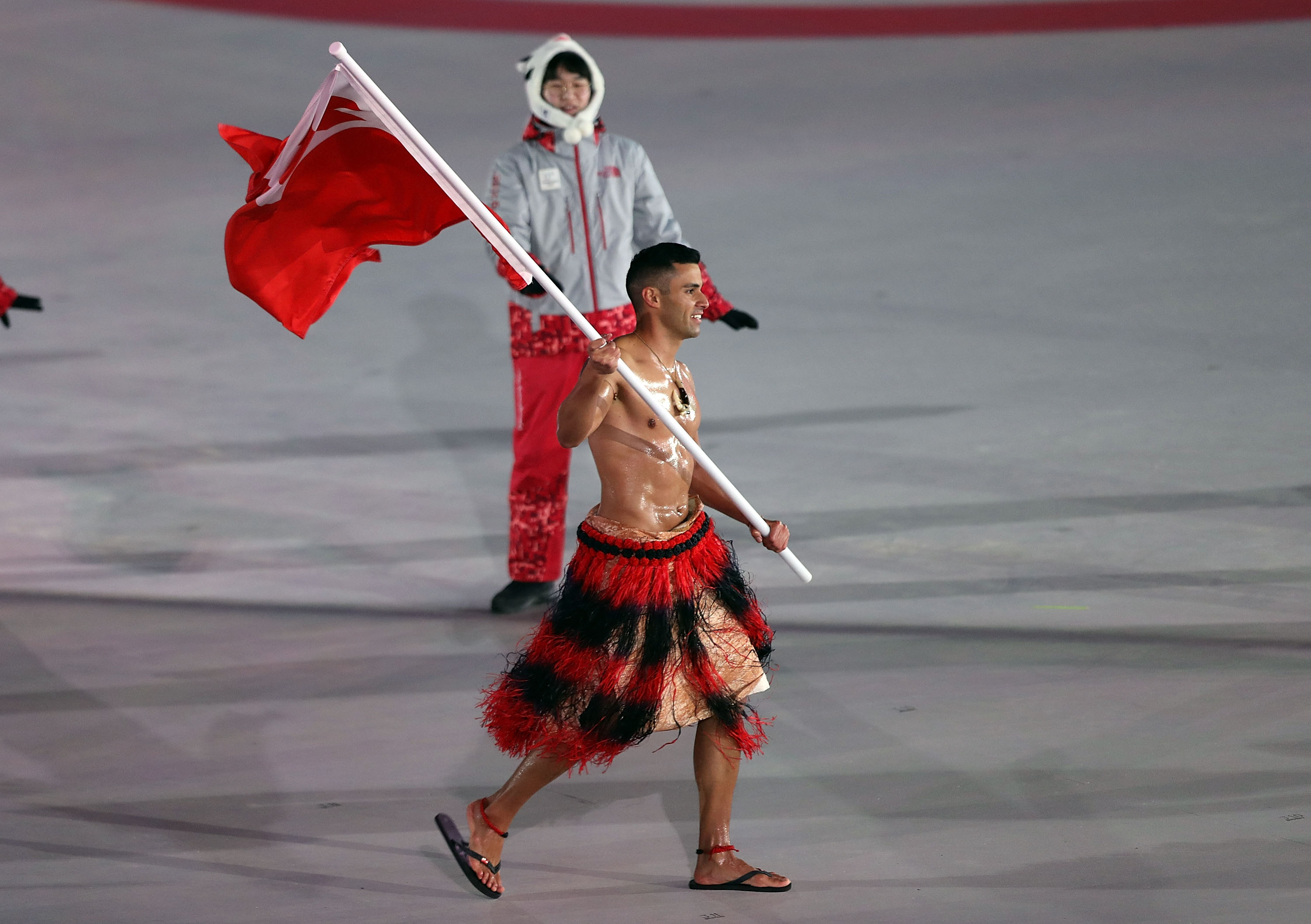 PYEONGCHANG-GUN, SOUTH KOREA - FEBRUARY 09:  : Flag bearer Pita Taufatofua of Tonga leads the team during the Opening Ceremony of the PyeongChang 2018 Winter Olympic Games at PyeongChang Olympic Stadium on February 9, 2018 in Pyeongchang-gun, South Korea.  fee liable image, copyright © ATP  Amin JAMALI  XXIII. OLYMPIC WINTER GAMES PYEONGCHANG 2018: OPENING CEREMONY,  PyeongChang, Korea, Winter Olympics; PyeongChang Olympic Stadium, on 9. February 2018, fee liable image, copyright © ATP / Amin JAMALI  Featuring: Flag bearer Pita Taufatofua of Tonga Where: Pyeongchang, Gangwon Province, South Korea When: 09 Feb 2018 Credit: ATP/WENN.com  **Not available for publication in Germany or France. No Contact Music.**