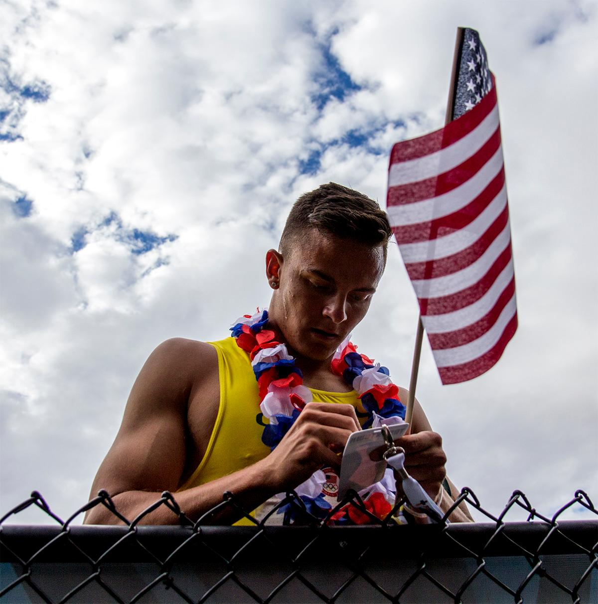 Oregon's Devon Allen signs autographs after storming to a victory in the 110 meter hurdles, taking the win in 13.03. Photo by August Frank, Oregon News Lab