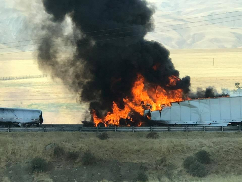 A photo provided by Eric Siefert shows the aftermath of a crash involving big rigs that shut down a portion of southbound Interstate 5 south of Bakersfield, Calif., Thursday, Aug. 10, 2017.