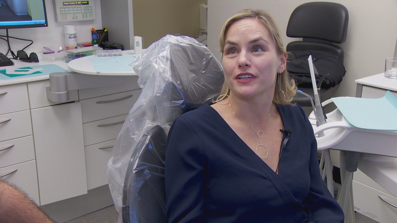 Blodgett's patient Jodi Bolka said after seeing her husband suffer through the old procedure, she opted to fix her gum recession with the pinhole method. (KATU)
