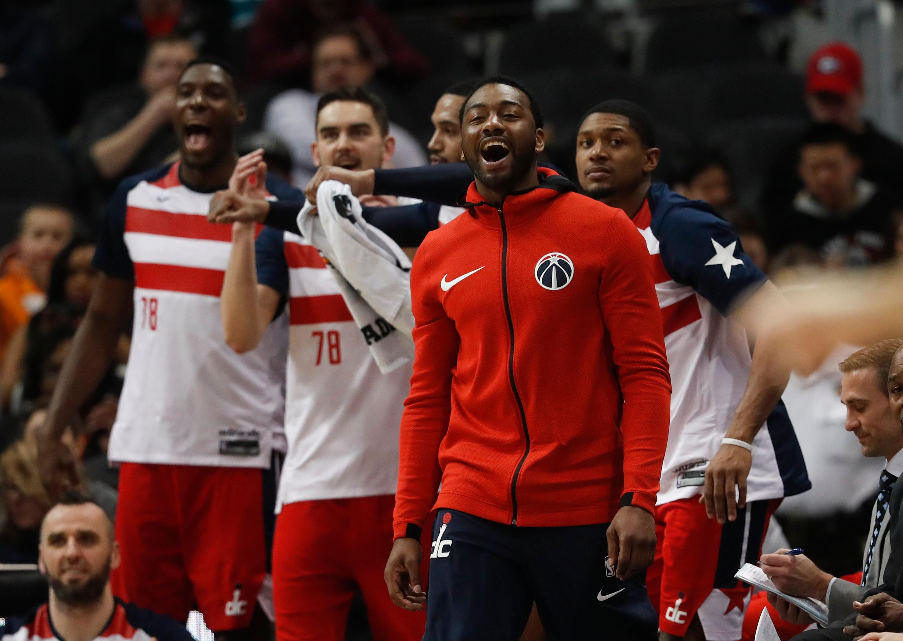 Washington Wizards guard John Wall (2) cheers from the bench in the second half of an NBA basketball game against the Atlanta Hawks Saturday, Jan. 27, 2018, in Atlanta. Washington won 129-104 (AP Photo/John Bazemore)