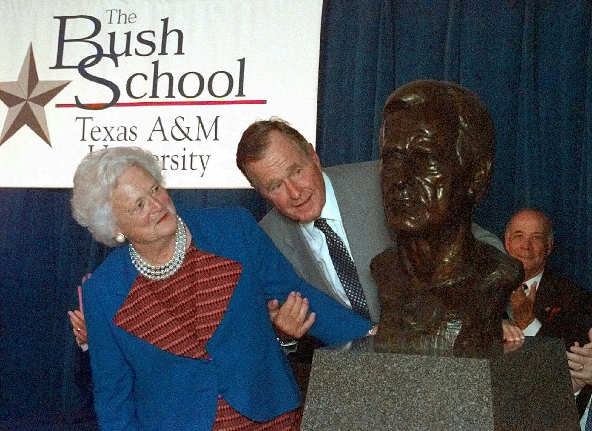 "FILE - In this Sept. 10, 1997 file photo, former President George Bush and his wife Barbara unveil a bust of the president during a ceremony to open The Bush School of Government and Public Service at Texas A&M University in College Station, Texas. Former first couple George and Barbara Bush's relationship is a true love story, described by granddaughter Jenna Bush Hager as ""remarkable."" They met at a Christmas dance. She was 17. He was 18. Two years later they were married. Now 73 years later, with Barbara Bush declining further medical care for health problems, they are the longest-married couple in presidential history. (AP Photo/David J. Phillip)"