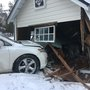 Sheriff: Woman crashes into garage to avoid other vehicle
