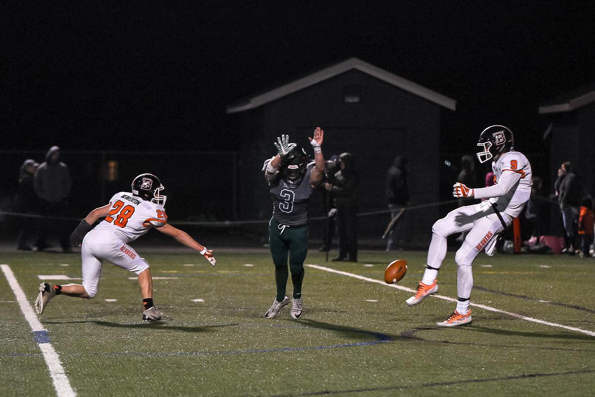 Sheldon defensive back Wyatt Seidel (#3) blocks a punt during Sheldon's 48-7 victory over Beaverton in the first round of the state high school playoffs.  Photo by Jeff Dean Oregon News Lab