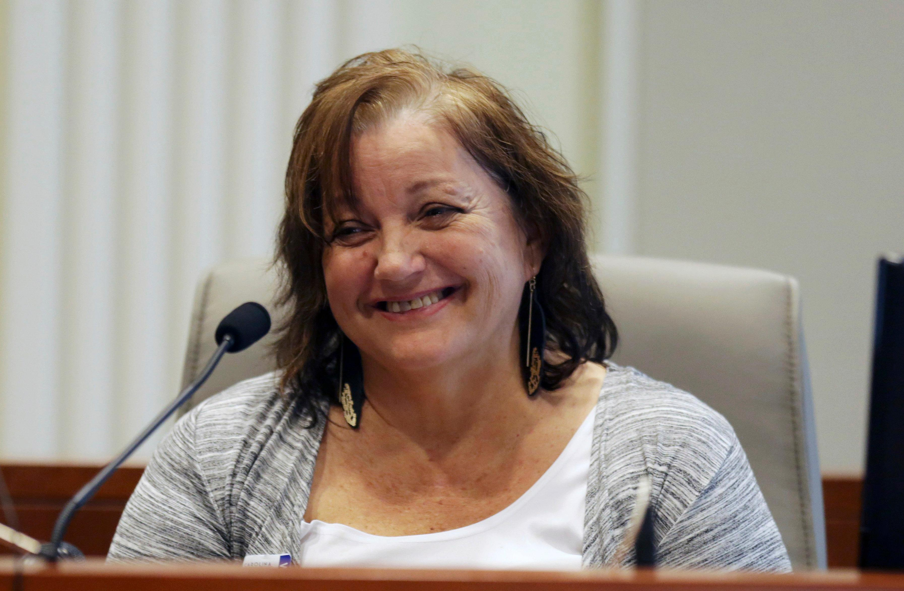 Sandra Dowless laughs under cross-examination during the public evidentiary hearing on the 9th Congressional District investigation at the North Carolina State Bar Monday, Feb. 18, 2019, in Raleigh. Dowless was surprised by evidence that McCrae Dowless was paid nearly $84,000 in consulting fees over five months leading into last year's general election. (Juli Leonard/The News & Observer via AP, Pool)