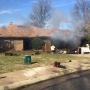 Smoke from house fire briefly shuts down Edmond road