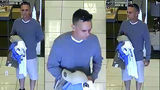 Police search for suspect accused of robbing clothing store employee