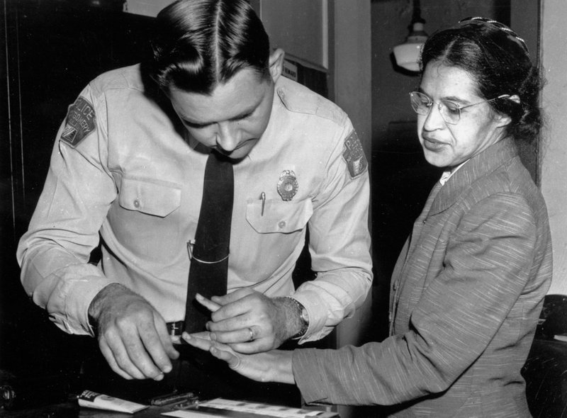 <p>FILE - In this Feb. 22, 1956, file photo, Rosa Parks is fingerprinted by police Lt. D.H. Lackey in Montgomery, Ala., after refusing to give up her seat on a bus for a white passenger on Dec. 1, 1955. Yellowing court records from the arrests of Rosa Parks, Martin Luther King Jr. and others at the dawn of the modern civil rights era are being preserved and digitized after being discovered, folded and wrapped in rubber bands, in a courthouse box. (AP Photo/Gene Herrick, File)</p>