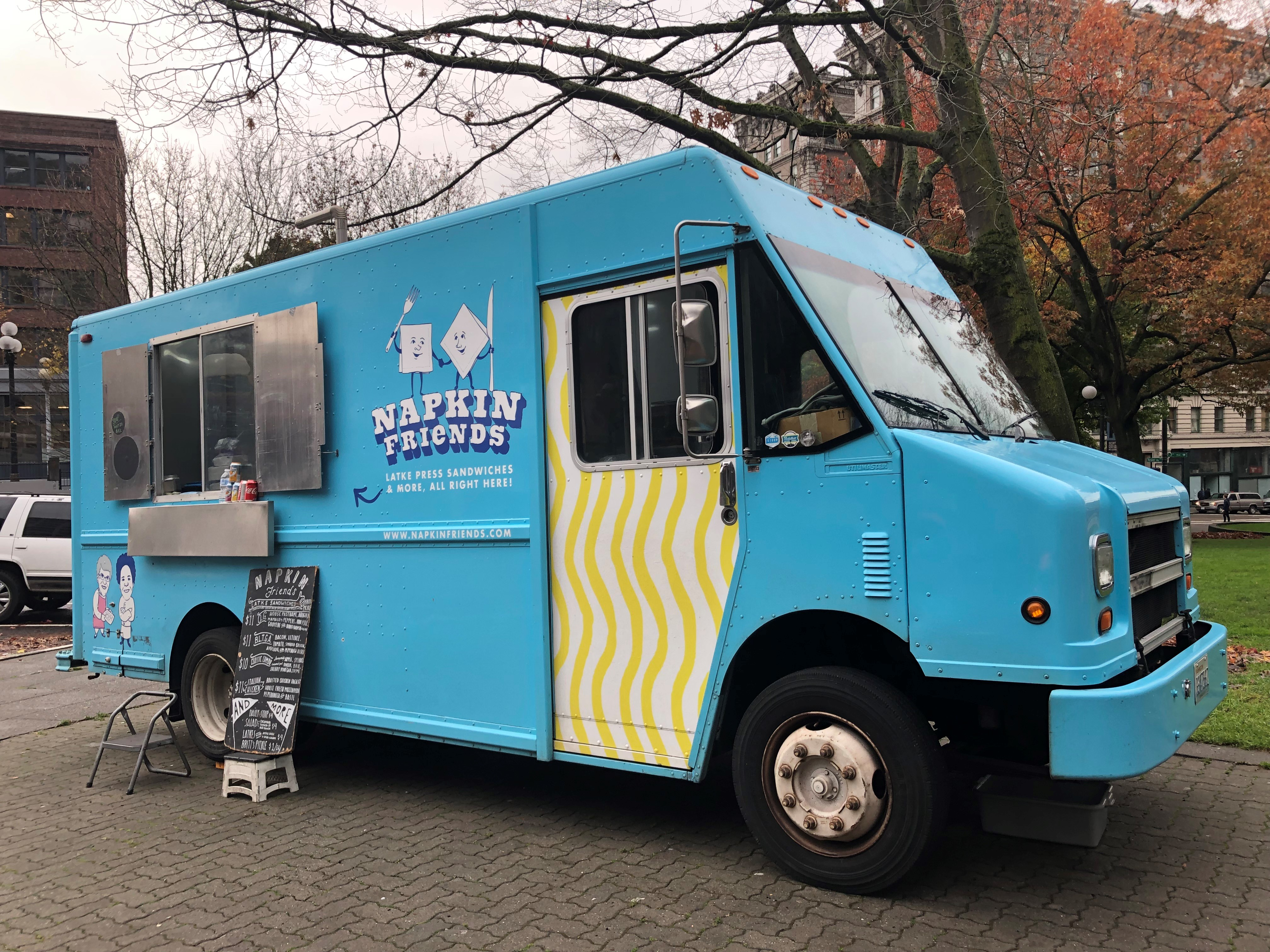 At Napkin Friends Food Truck, Chef Jonny Silverberg and his crew serve up mouth watering latkes. They have fresh twist on potato pakcakes, using them in place of bread to create mouthwatering sandwiches. In addition to the O.G. (their signature sammie) and three others, their menu also features Jewish food faves like Matzoh Ball Soup.{ } (Image Napkin Friends)