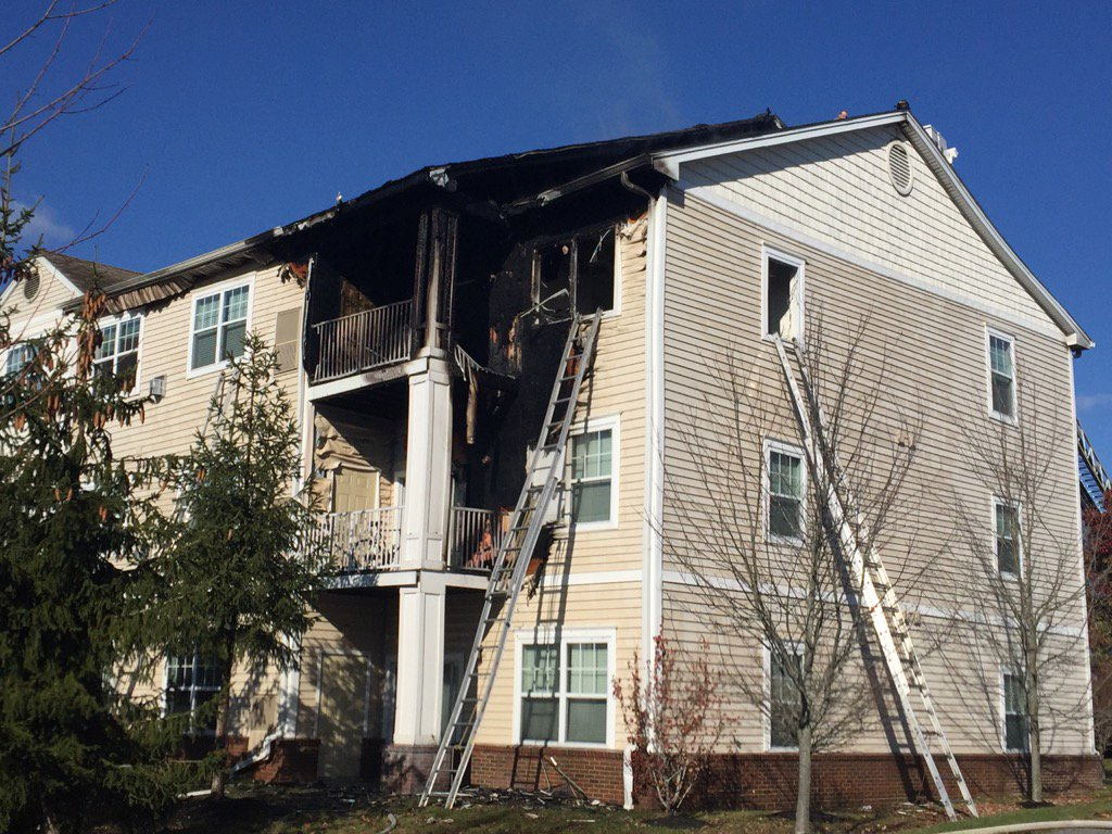 Fire burns through a Liberty Commons apartment complex on Westbrook Street in South Portland (WGME)