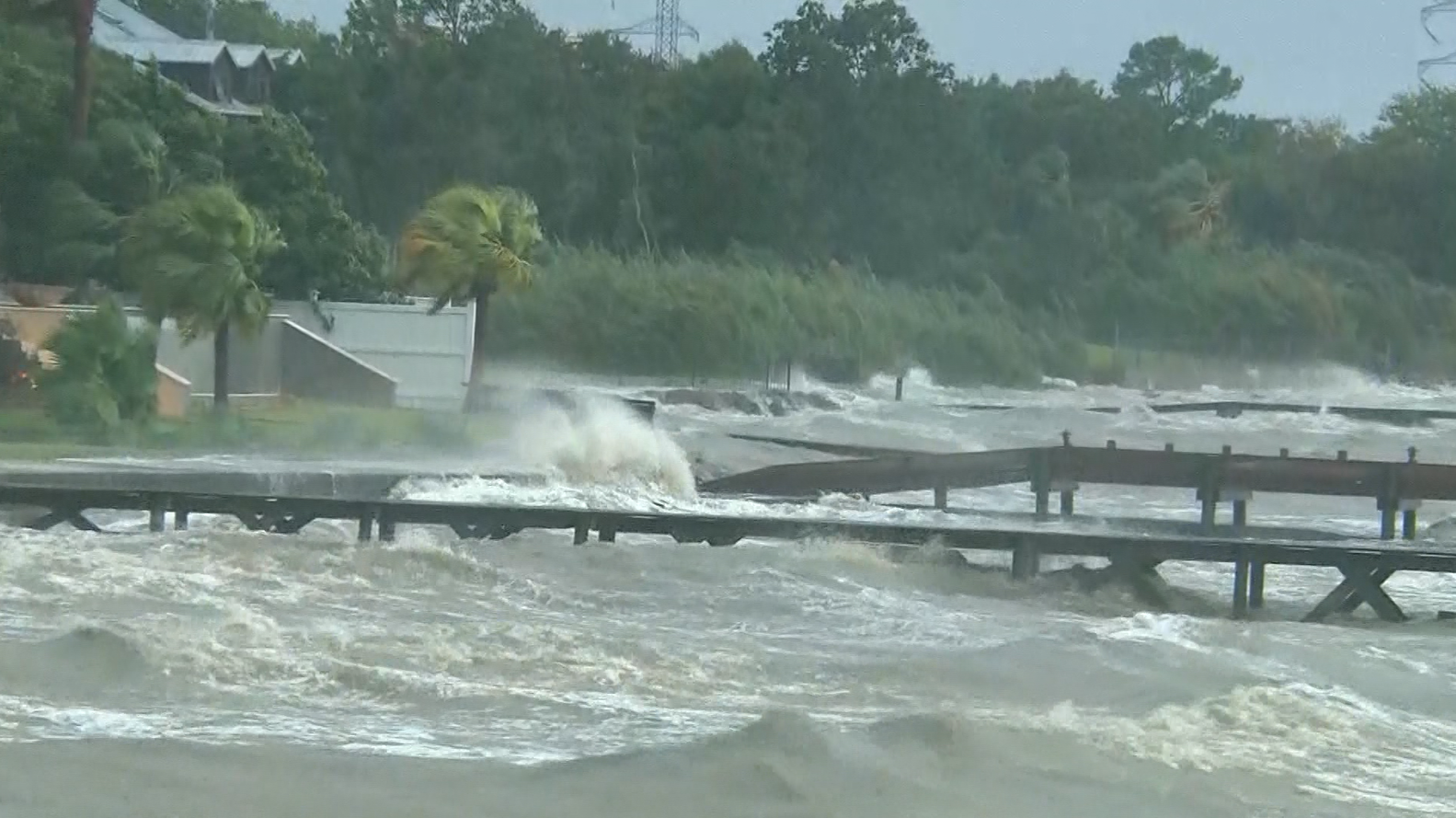 Waves crashing over piers in Kemah, Texas (CNN)