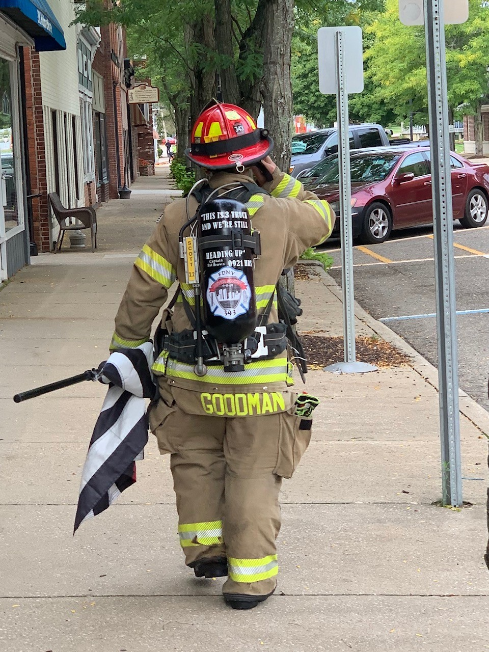 Allegan Fire Department Lieutenant Chris Goodman walking the streets on September 11, 2020. Wearing a tank with the names of one of the 343 firefighters that died on September 11, 2001. (WWMT/Felicia Belden)