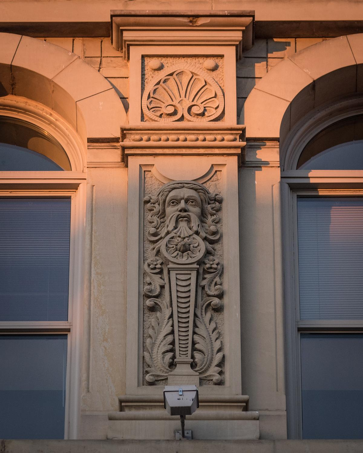 A Narrow Home That Keeps Its Eyes On The Street: The Sculpted Faces Of Cincy's Places