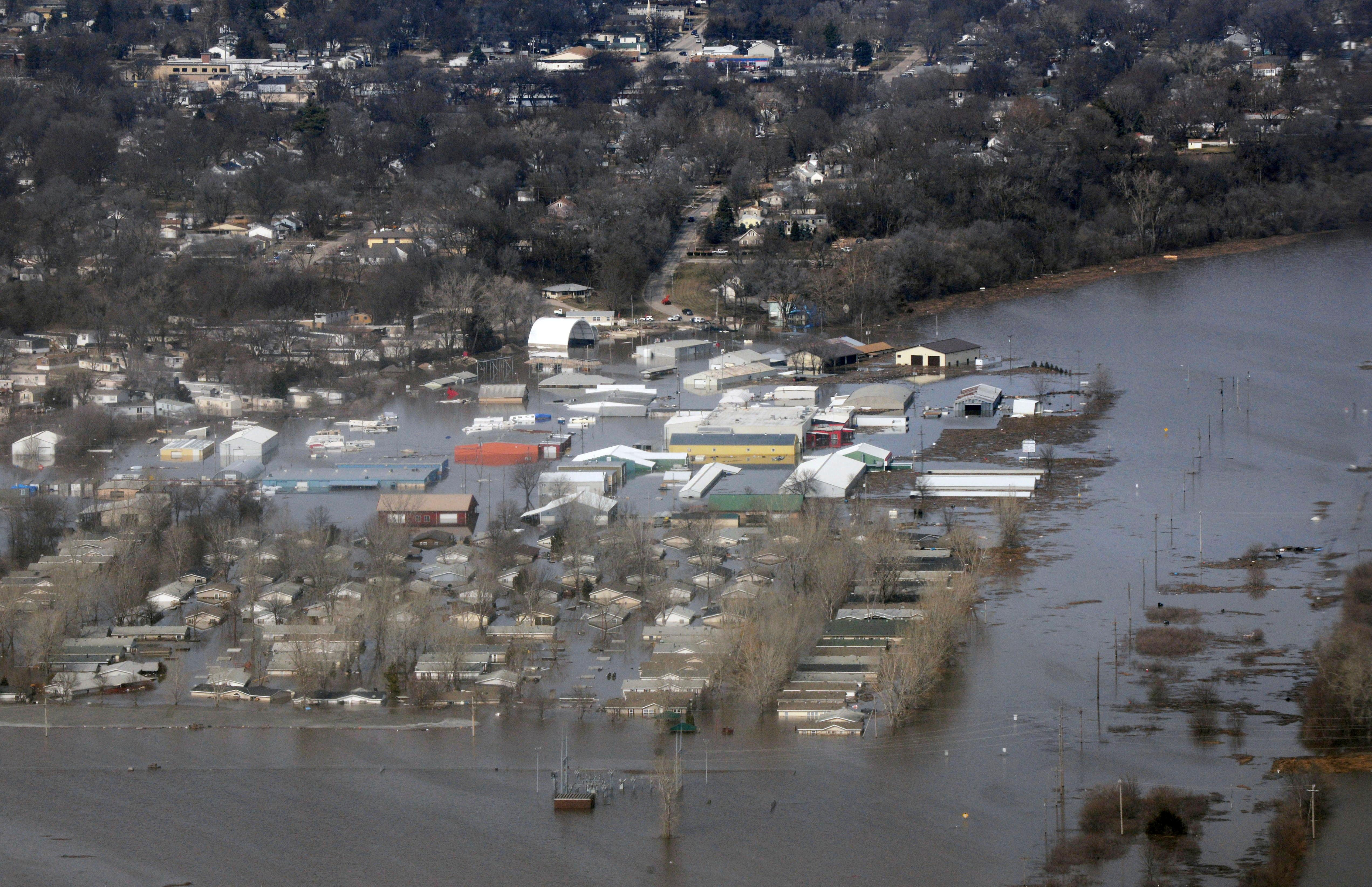 This March 17, 2019 photo released by the U.S. Air Force shows an aerial view of Areas surrounding Offutt Air Force Base affected by flood waters in Neb.{ } (Tech. Sgt. Rachelle Blake/The U.S. Air Force via AP)