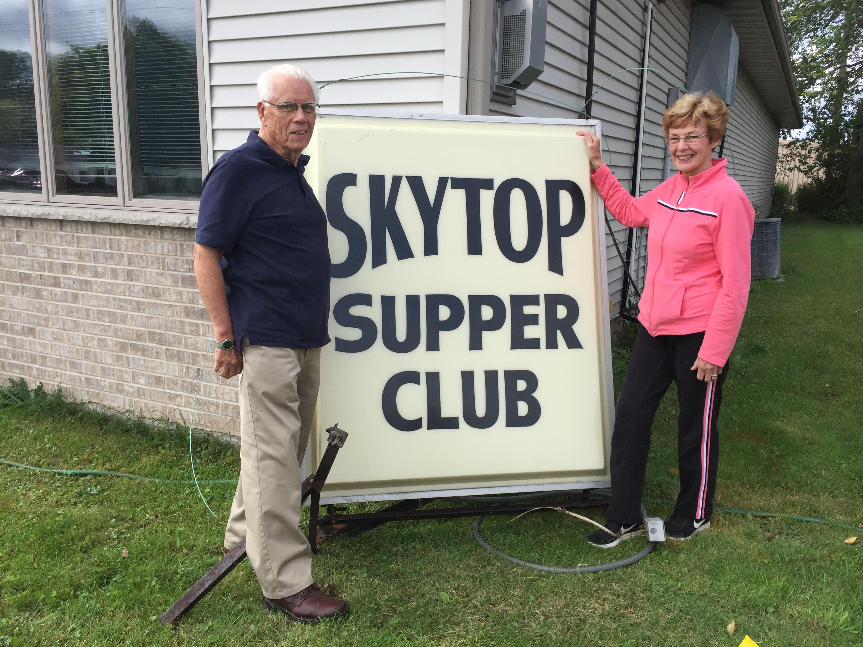 Vern Krawczyk and Judy Krawczyk pose with Sky Top Supper Club sign in Green Bay, September 6, 2017 (WLUK/Eric Peterson)
