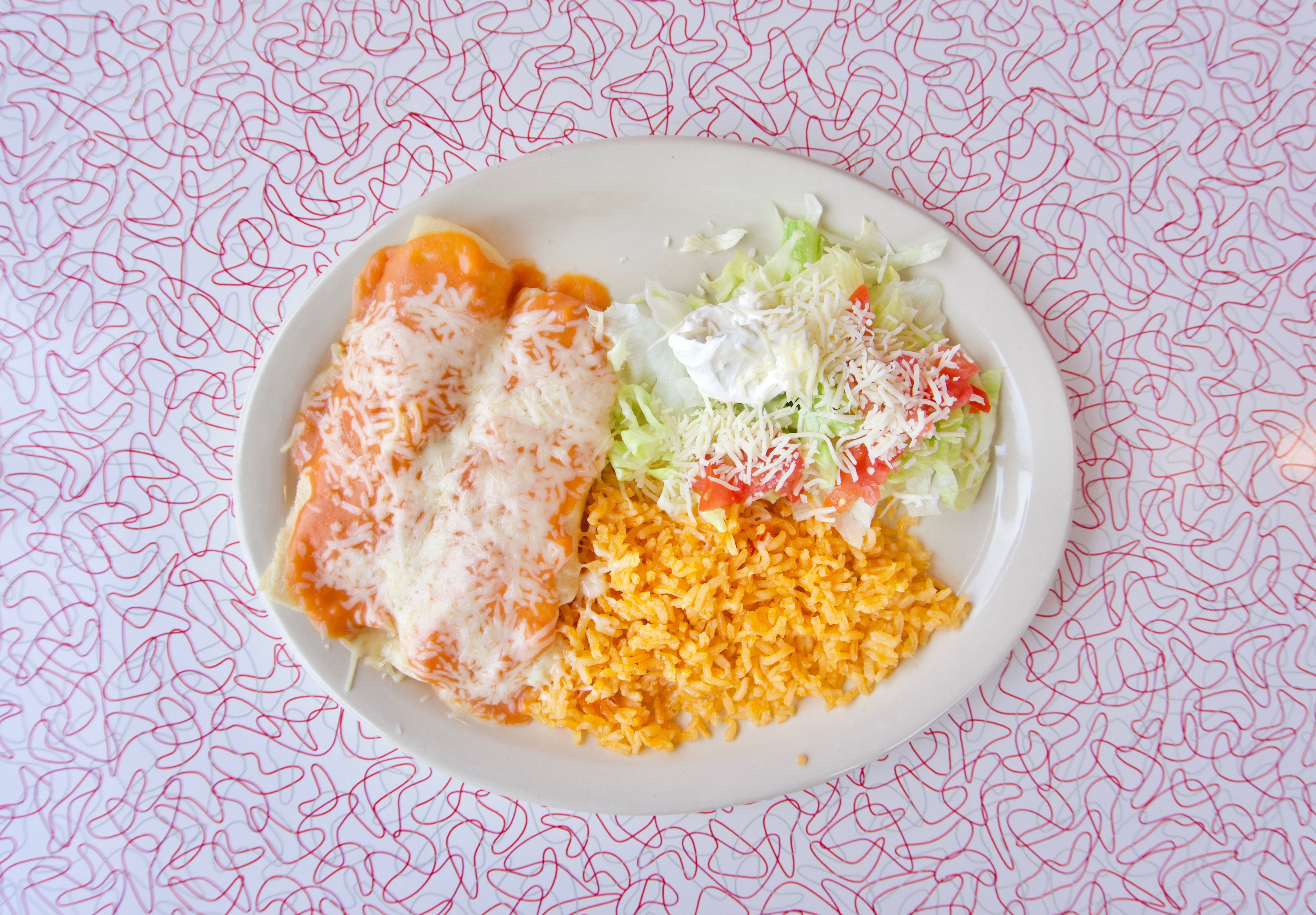 Chicken enchiladas with rice and beans / Image: Brian Planalp // Published: 5.20.18