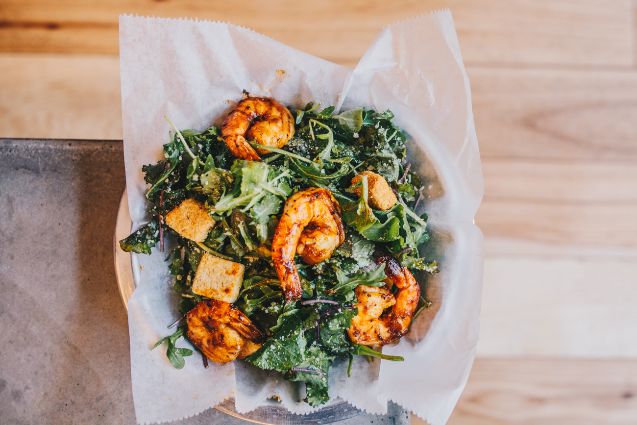 Red pepper Caesar salad with honey glazed shrimp: chopped romaine lettuce, house made red pepper Caesar dressing, and parmesan cheese / Image: Catherine Viox // Published: 2.25.19
