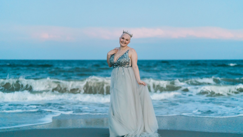 Natalie Thomas, a 25-year-old from Myrtle Beach diagnosed with cancer, poses on the beach during the photo-shoot that has inspired her to push for Disney to create a bald princess (Credit: Dustin McKibben)