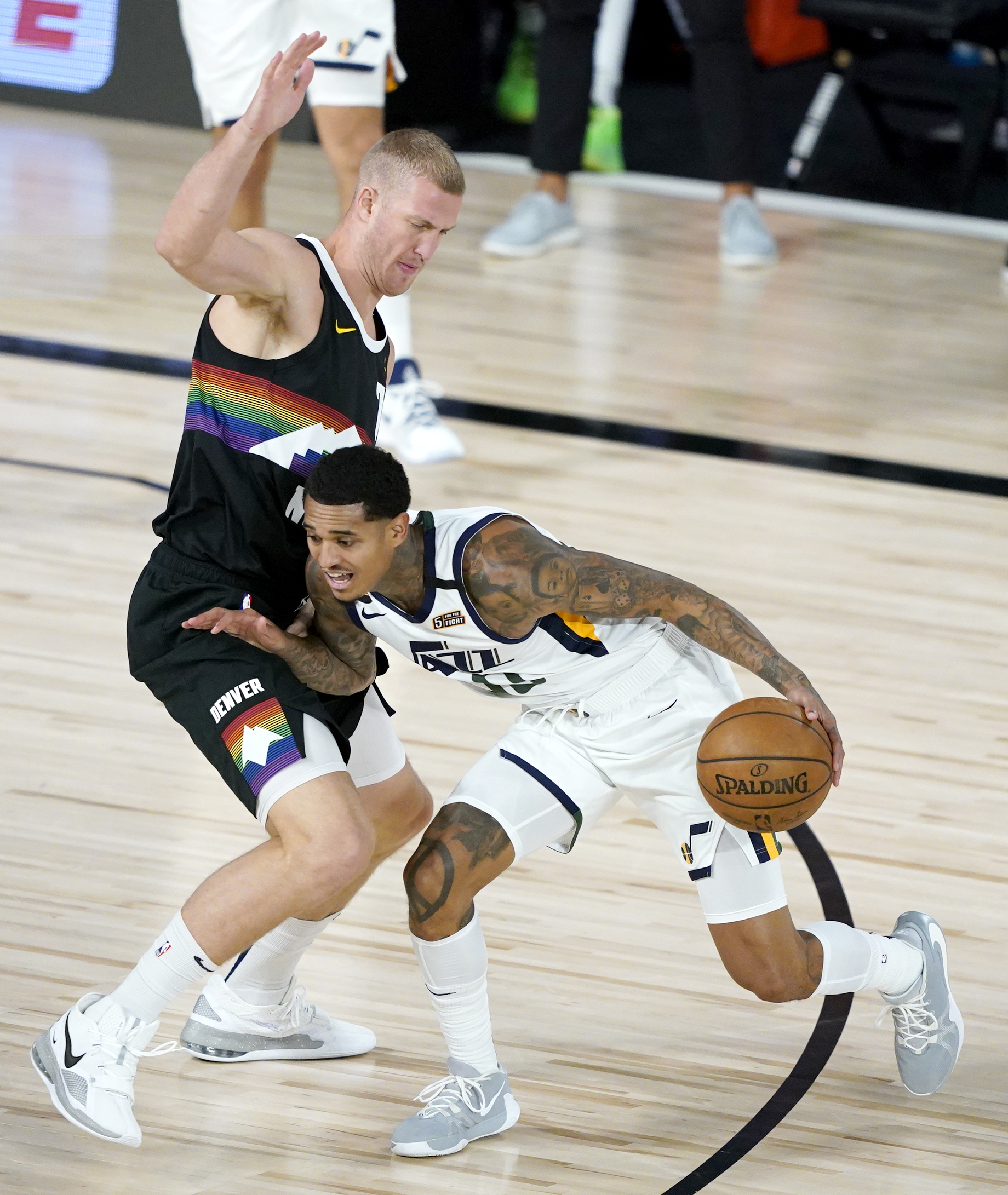 Utah Jazz's Jordan Clarkson (00) drives against Denver Nuggets' Mason Plumlee (7) during the first half of an NBA basketball first round playoff game, Monday, Aug. 17, 2020, in Lake Buena Vista, Fla. (AP Photo/Ashley Landis, Pool)