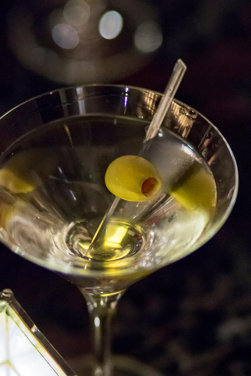 Bring your friends and enjoy live Jazz music and happy hour specials Monday - Friday from 4-7pm at The Bar at Palm Court.  Shown here is the Martini shaken with your choice of Tanqueray or Stolichnaya. / Image: Allison McAdams