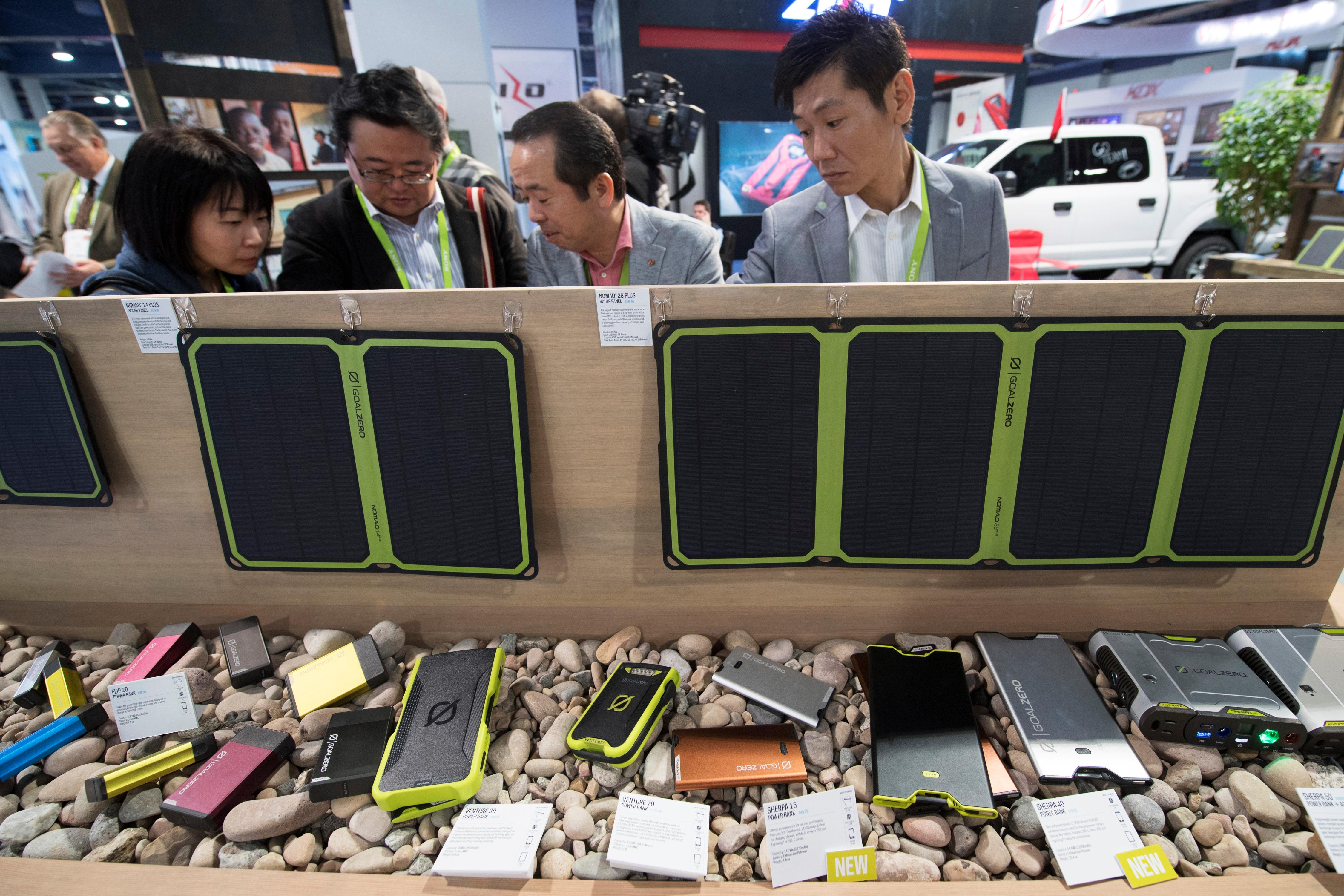 Attendees check out portable solar panels during the second day of CES Wednesday, January 10, 2018, at the Las Vegas Convention Center. CREDIT: Sam Morris/Las Vegas News Bureau