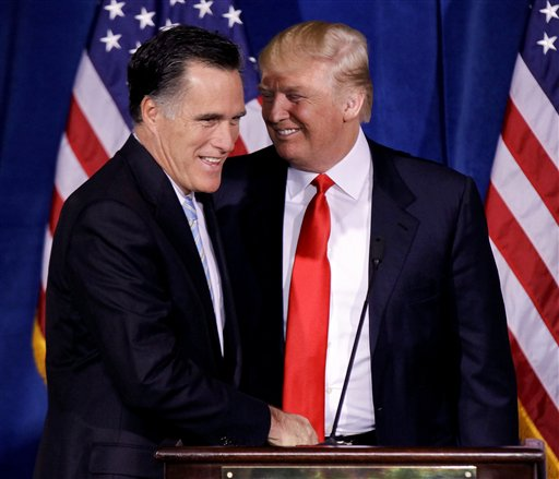 Donald Trump greets Republican presidential candidate, former Massachusetts Gov. Mitt Romney during a news conference in Las Vegas.