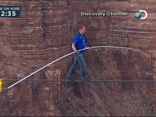 Nik Wallenda walks a tightrope 1,500 feet above the Little Colorado River Gorge near the Grand Canyon.