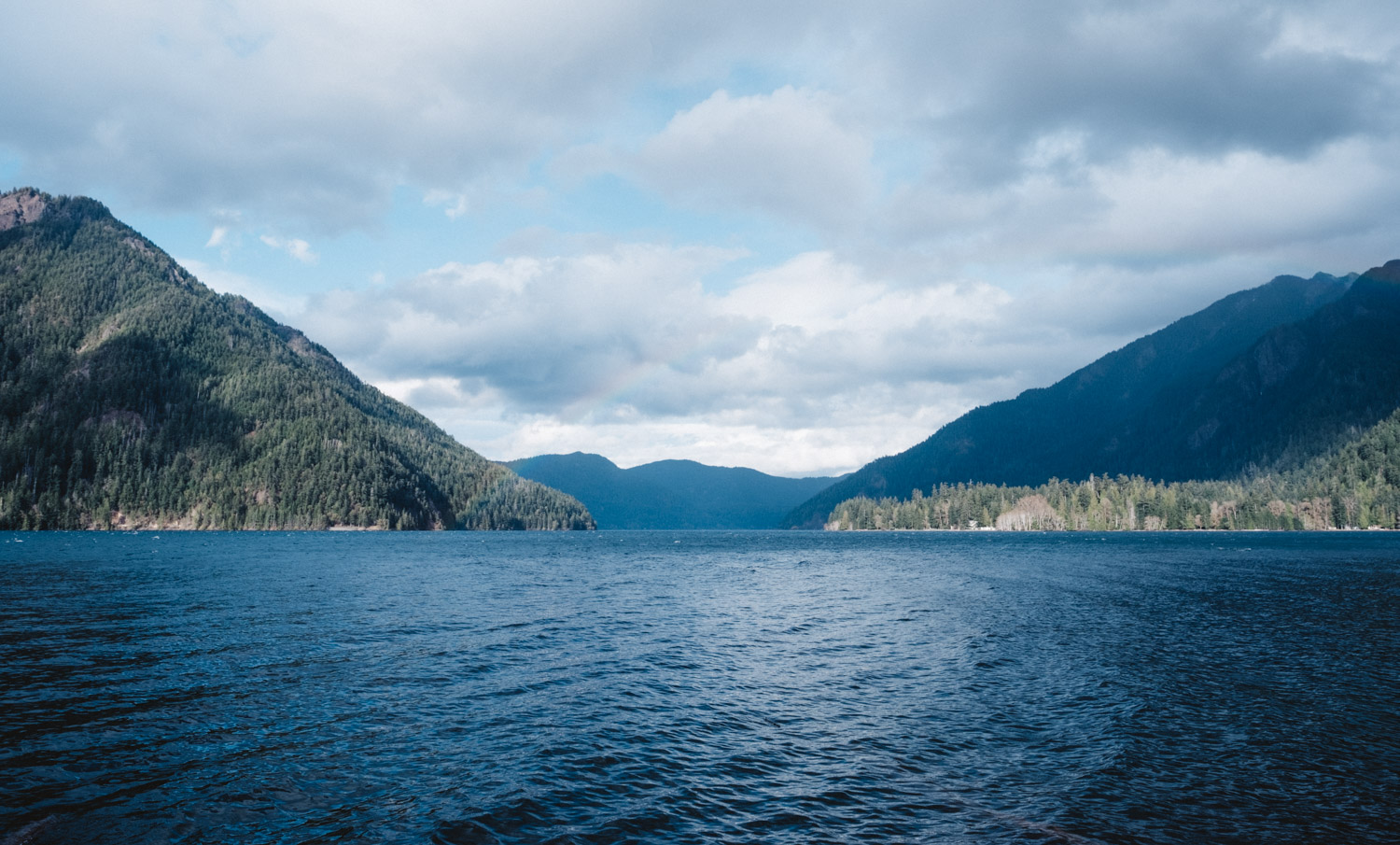 Lake Crescent - Lying 18 miles west of Port Angeles and nestled between the foothills of the Olympic Mountains, Lake Crescent draws visitors with its pristine waters and various campgrounds and hiking trails. Check out the Mt. Storm King ranger station, have a picnic and take a dip in the lake, or hike to the gorgeous Marymere Falls. (Image: Ryan McBoyle / Seattle Refined)