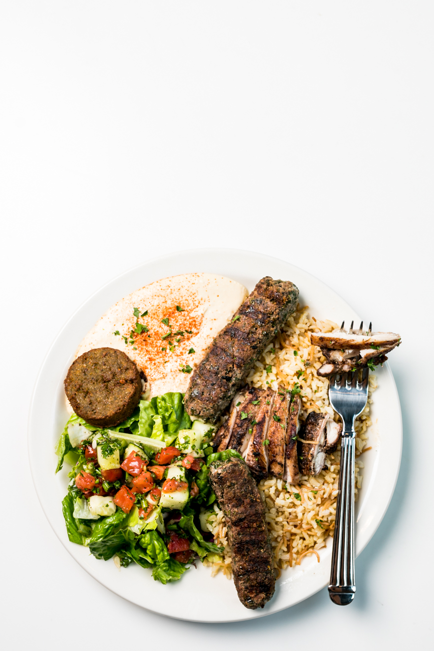 Flavor Savor Special: Chicken mishwi and beef kafta on a bed of seasoned brown rice with vermicelli, served with greens, hummus, and falafel / Image: Amy Elisabeth Spasoff // Published: 7.19.18