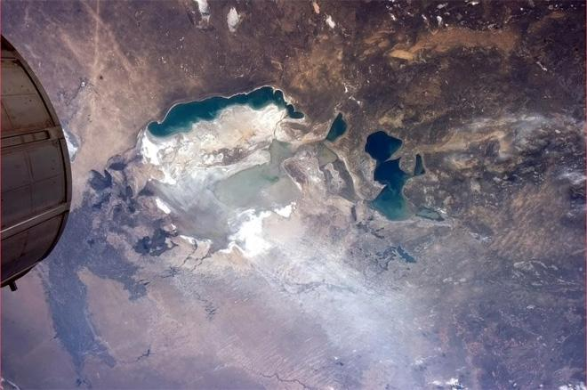 Dust blows from what was once the Aral Sea floor. Tragic mismanagement of a natural resource. (Photo & Caption: Col. Chris Hadfield, NASA)