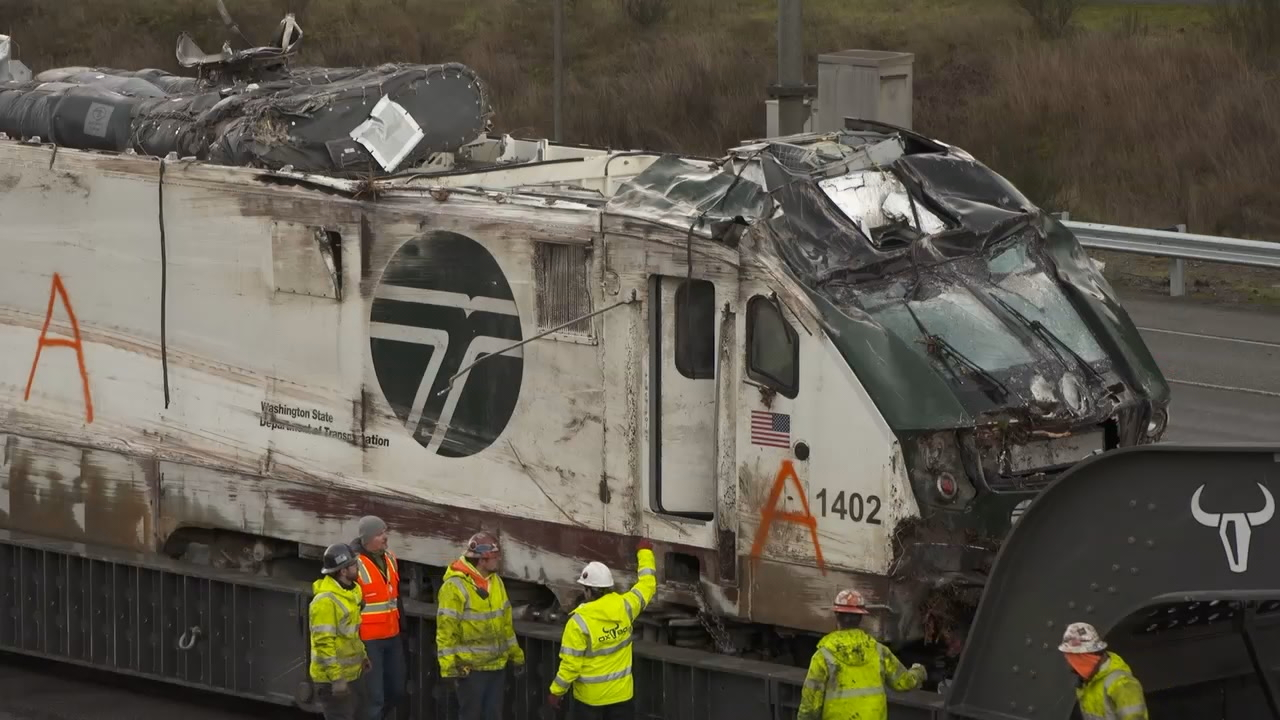 Crews work to remove a damaged Amtrak train, Wednesday, Dec. 20, 2017. (KOMO)