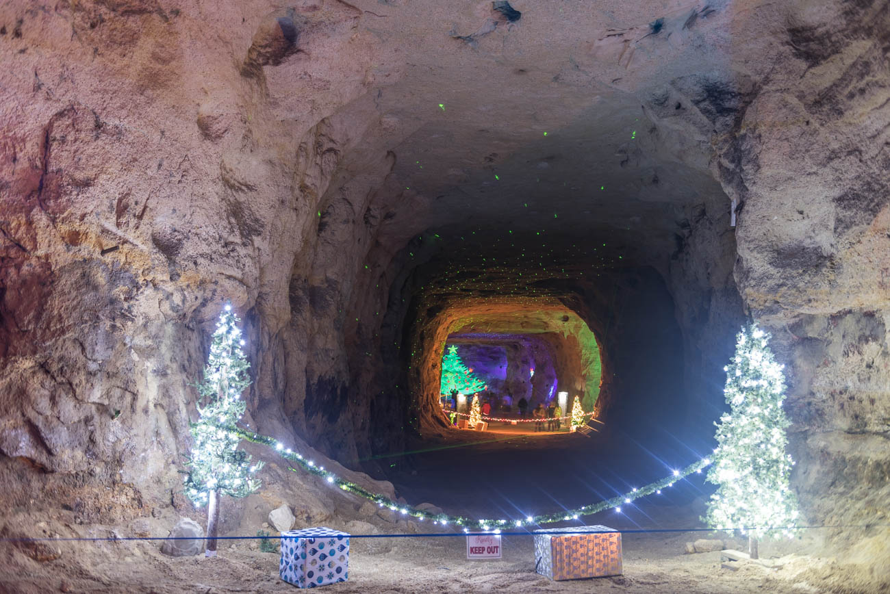 "Christmas Cave is exactly what you think it is: lights and decorations in festive, Christmas stylings inside a ""cave."" Alright, it's actually located inside the White Gravel Mines in Minford, OH (two hours east of Cincinnati). The attraction places Christmas trees and Biblical displays throughout the cave for visitors to enjoy on self-guided tours. While there isn't an admission fee, a $1 donation is encouraged. It's open from 4-10 PM every Friday and Saturday evening until Christmas. ADDRESS: 4007 White Gravel McDaniel Road, Minford, OH (45653) / Image: Mike Menke // Published: 12.16.18"