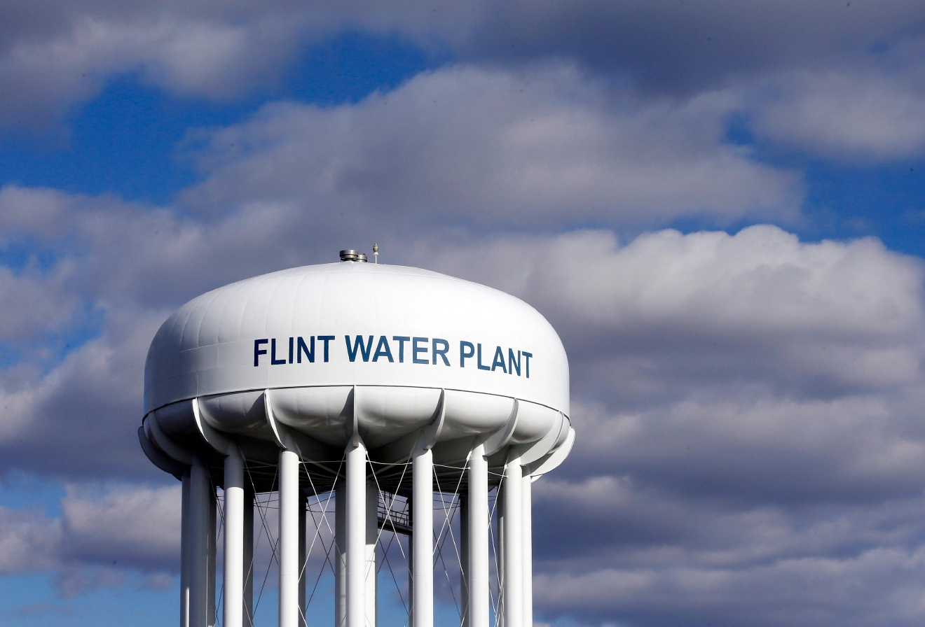 FILE - In this March 21, 2016 file photo, the Flint Water Plant water tower is seen in Flint, Mich. (AP Photo/Carlos Osorio, File)
